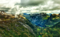 Geirangerfjord is seen in the valley below the mountains surrounding this popular Norwegian town.