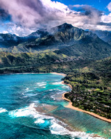 Lush mountain greenery, turquoise colored seas and beautiful beaches can be seen from this Kauai coast aerial in Hawaii.